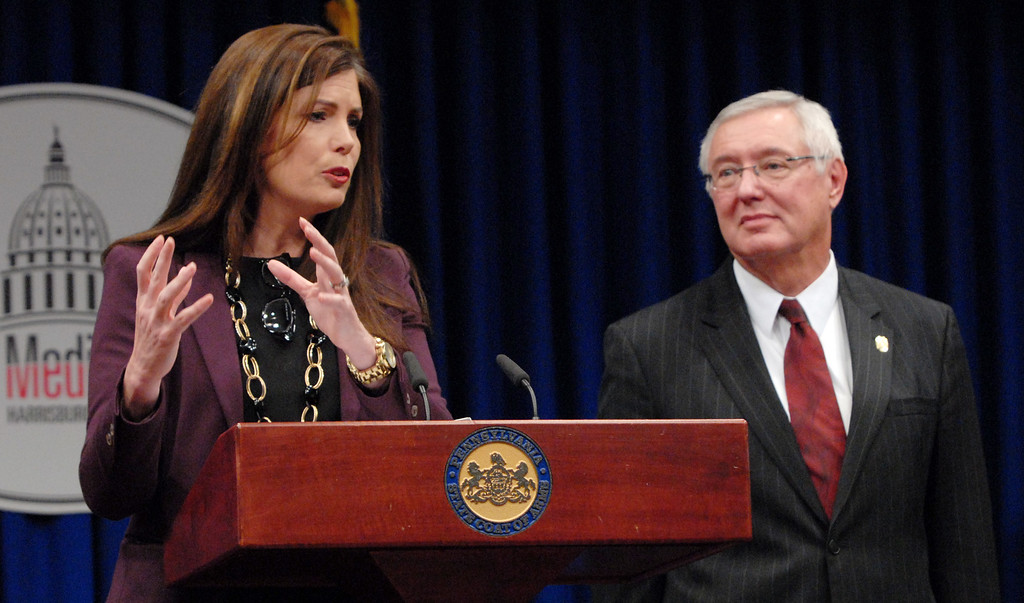 """. Pennsylvania Attorney General Kathlen Kane, left and Pennsylvania State Police Commissioner Frank Noonan conduct a news conference at the Capitol announcing charges against a former state Senate leader and seven others in what they called a \""""pay to play\"""" case involving the Pennsylvania Turnpike Thursday, March 13, 2013 in Harrisburg, Pa. (AP Photo/Bradley C  Bower)"""