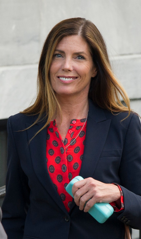 . Pennsylvania Attorney General Kathleen Kane leaves the Montgomery County courtroom where her trial for leaking grand jury testimony and then lying about it is underway, Wednesday. Aug. 10, 2016, in Norristown, Pa. Kane is charged with perjury and obstruction for allegedly publicizing grand jury files about an investigation of a civil rights leader. (Clem Murray/Philadelphia Inquirer via AP, Pool)
