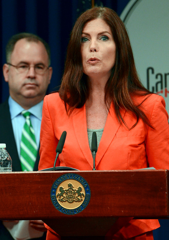 . Attorney General Kathleen Kane speaks during a news conference Friday, June 27, 2014, at the Capitol in Harrisburg, Pa. Gov. Tom Corbett and Kane announced details of an agreement to allow some Highmark insurance enrollees under certain conditions to continue using its doctors and facilities at in-network rates under a consent decree filed in court Friday, after a long and bitter fight between the two western Pennsylvania health care giants.  Looking on is Pennsylvania Insurance Commissioner Michael Consedine. (AP Photo/Marc Levy)
