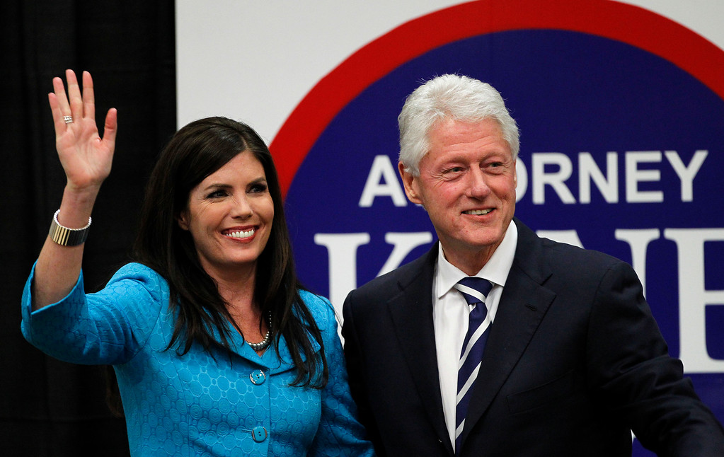 . Kathleen Kane, left, a democratic candidate for Pennsylvania Attorney General, waves with President Bill Clinton after he endorsed her in a speech at Upper Moreland High School Thursday, April 12, 2012 in Willow Grove, Pa. (AP Photo/Alex Brandon)