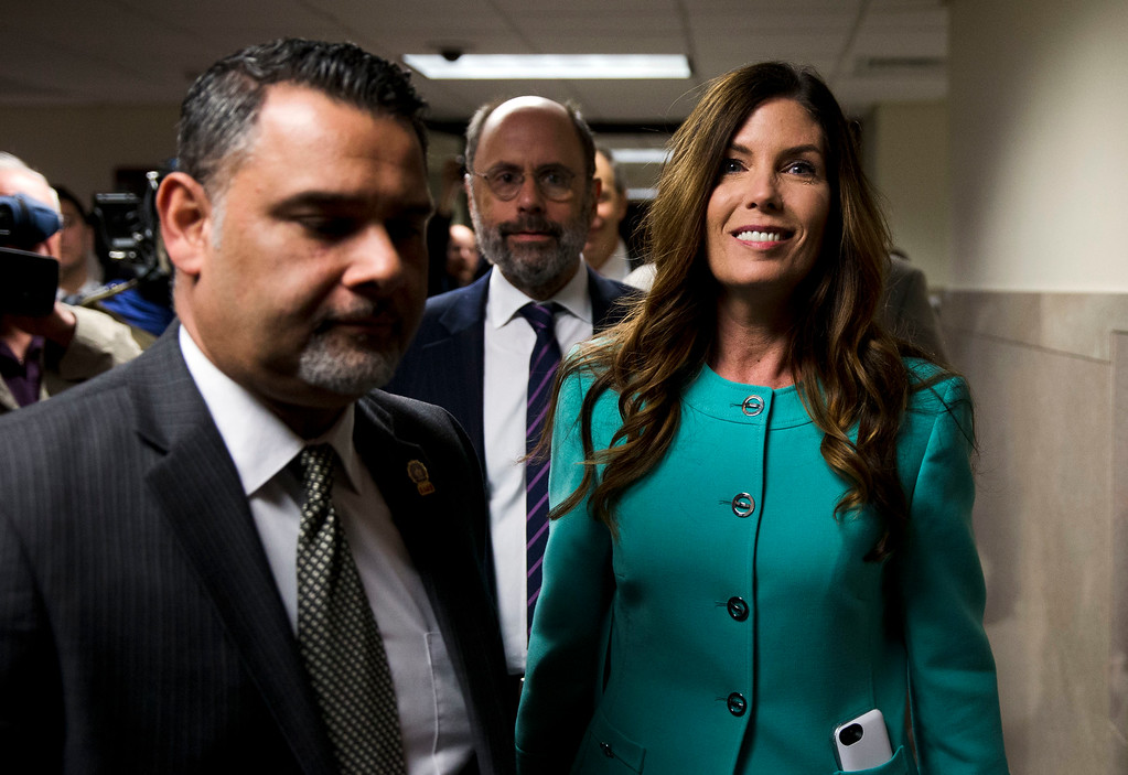 . Pennsylvania Attorney General Kathleen Kane departs after a pretrial hearing in her grand jury leak case, Wednesday, April 20, 2016, at the Montgomery County courthouse in Norristown, Pa. Kane is accused of leaking secret grand jury information to the press, lying under oath and ordering aides to illegally snoop through computer files to keep tabs on an investigation into the leak. (AP Photo/Matt Rourke)