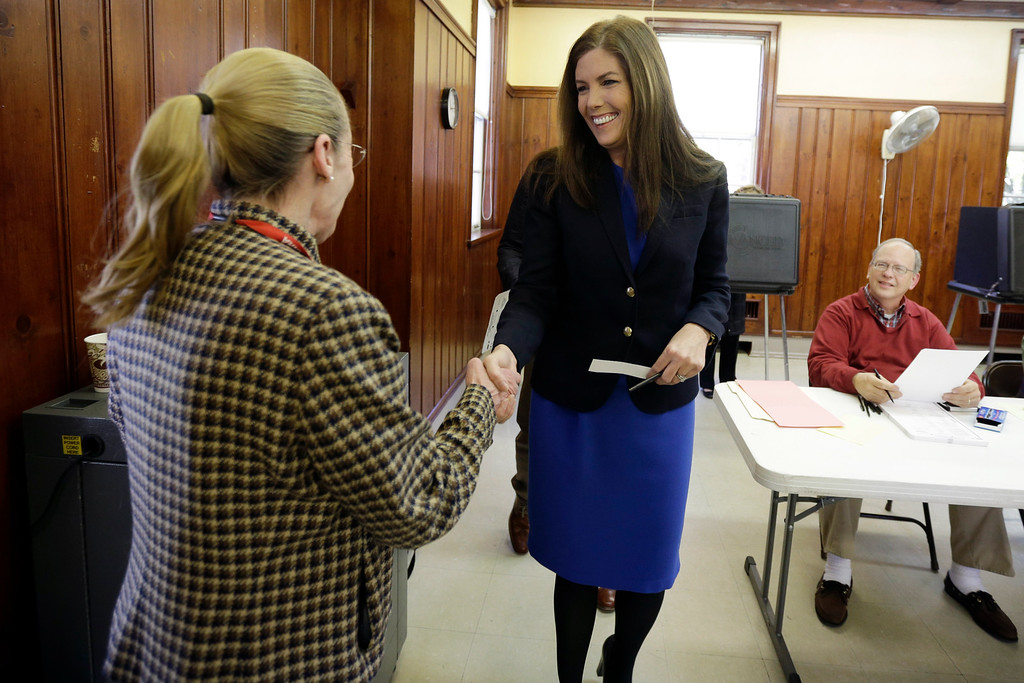 . Kathleen Kane, democratic candidate for Pennsylvania Attorney General, greets judge of elections Pamela Symes after voting at a polling place in the Waverly Community House, Tuesday, Nov. 6, 2012, in Waverly, Pa. (AP Photo/Matt Slocum)