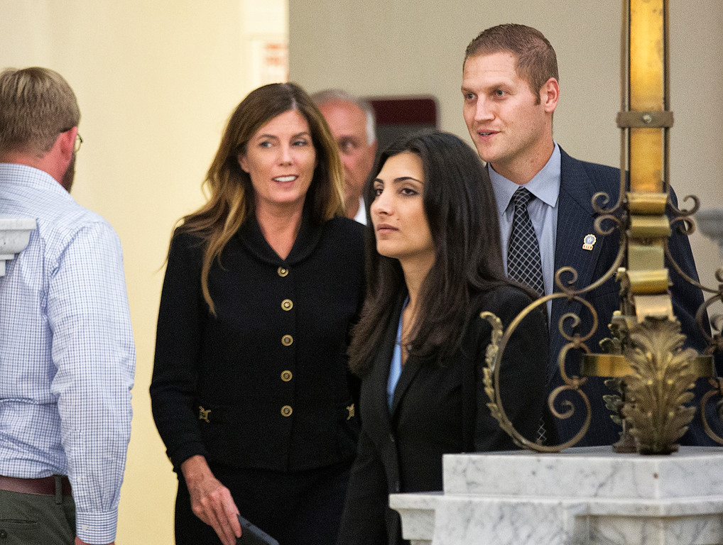 . Pennsylvania Attorney General Kathleen Kane, second left, and members of her legal and security teams, prepare to leave the Montgomery County Courthouse and await a verdict, in Norristown, Pa., Monday, Aug. 15, 2016. Kane was convicted Monday of all nine charges against her in a perjury and obstruction case related to a grand jury leak but insisted she\'s innocent and vowed to appeal. Kane, the first Democrat and first woman elected to the office, showed little emotion as jurors announced their verdict Monday. (Ed Hille/The Philadelphia Inquirer via AP, Pool)