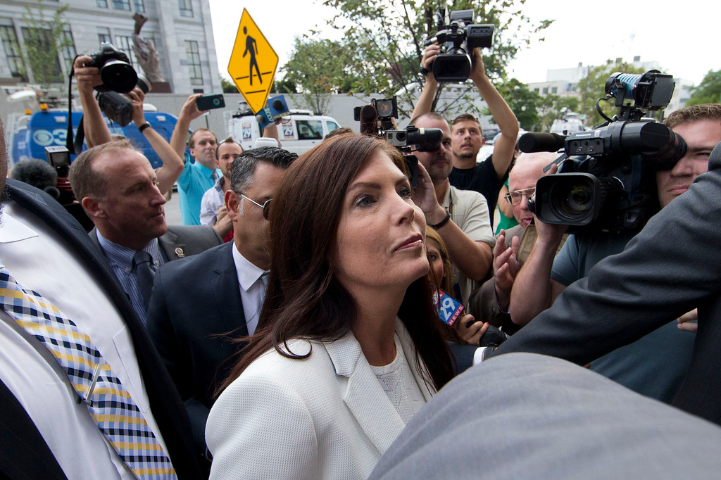. Pennsylvania Attorney General Kathleen Kane arrives to be processed and arraigned on charges she leaked secret grand jury material and then lied about it under oath, Saturday, Aug. 8, 2015, at the Montgomery County detective bureau in Norristown, Pa. Kane, the state�s first elected female attorney general, vows to fight the charges, which include perjury, obstruction and conspiracy. (AP Photo/Matt Rourke)