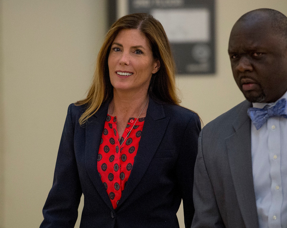 . Pennsylvania Attorney General Kathleen Kane returns from the afternoon break to the Montgomery County courtroom where her trial for leaking grand jury testimony and then lying about it is underway Wednesday. Aug. 10, 2016, in Norristown, Pa.  Kane is charged with perjury and obstruction for allegedly publicizing grand jury files about an investigation of a civil rights leader. (Clem Murray/Philadelphia Inquirer via AP, Pool)