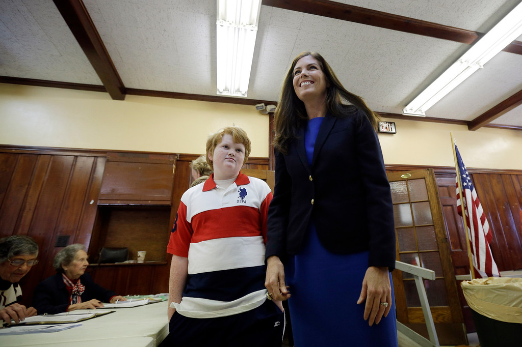 . Kathleen Kane, democratic candidate for Pennsylvania Attorney General, right, walks with her son Chris Kane, 11, as she prepares to vote at a polling place in the Waverly Community House, Tuesday, Nov. 6, 2012, in Waverly, Pa. (AP Photo/Matt Slocum)