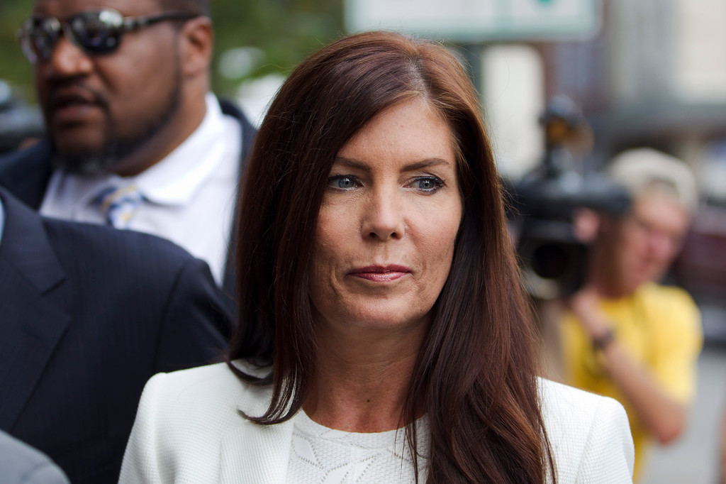 . Pennsylvania Attorney General Kathleen Kane arrives to be processed and arraigned on charges she leaked secret grand jury material and then lied about it under oath, Saturday, Aug. 8, 2015, at the Montgomery County detective bureau in Norristown, Pa. Kane, the state�s first elected female attorney general, vows to fight the charges, which include perjury, obstruction and conspiracy. (AP Photo/Laurence Kesterson)