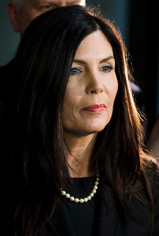 . FILE - In this March 11, 2015 file photo, Pennsylvania Attorney General Kathleen Kane walks from the State Supreme Court room at City Hall in Philadelphia. Kane spokesman Chuck Ardo said Thursday, Aug. 6, 2015, that Kane is aware of reports she faces criminal charges. A grand jury recommended in December that Kane be charged in connection with allegations she unlawfully leaked information from a 2009 investigation. (AP Photo/Matt Rourke, File)