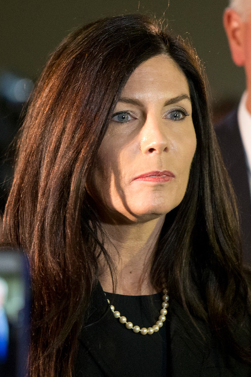 . Pennsylvania Attorney General Kathleen Kane walks from the State Supreme Court room, Wednesday, March 11, 2015, at City Hall in Philadelphia. The court heard arguments on the legality of a special prosecutor who led a grand jury investigation. The grand jury has recommended charges against her.  (AP Photo/Matt Rourke)