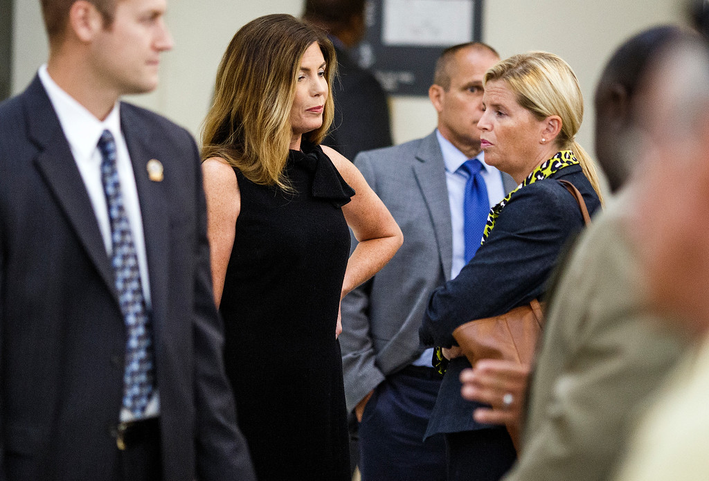. Pennsylvania Attorney General Kathleen Kane, left, takes a morning break during the fifth day of her trial at the Montgomery County Courthouse in Norristown, Pa.,  Friday, Aug. 12, 2016. Kane faces perjury and other charges related to the alleged leak of secret grand jury materials. (Dan Gleiter /PennLive.com via AP, Pool) Dan Gleiter, PennLive.com