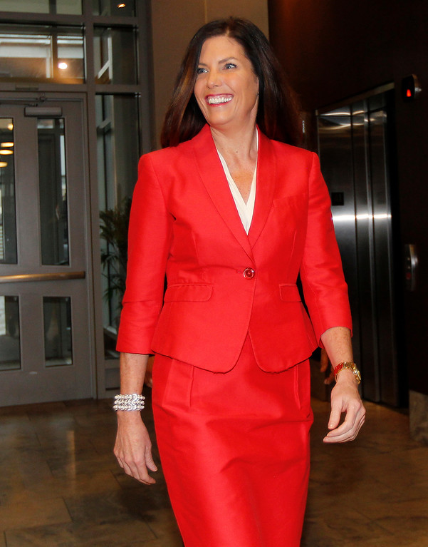 . Pennsylvania Attorney General Kathleen Kane walks to a news conference in Scranton, Pa., Tuesday, Feb. 16, 2016. Kane said she will not seek a second term, facing pressure from within her own party after being hobbled for months by criminal perjury charges and the suspension of her law license. (AP Photo/Rich Schultz)