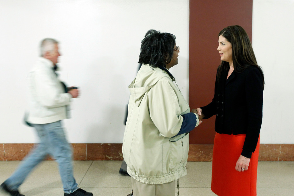. Former Lackawanna County prosecutor Kathleen Kane, right, campaigns for the the Democrat nomination to run for the Pennsylvania Attorney General, at Suburban Station, Monday, April 23, 2012, in Philadelphia. (AP Photo/Matt Rourke)