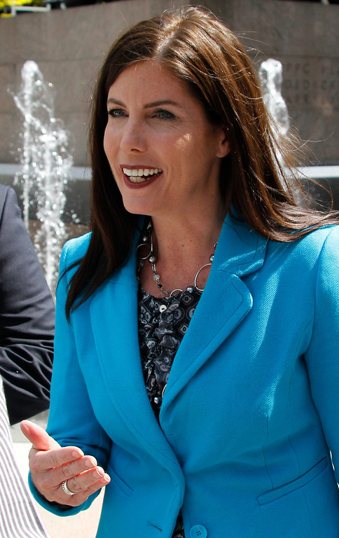 . Kathleen Kane, a candidate in the Democratic primary race for Pennsylvania state attorney general, talks with supporters before a news conference where Pennsylvania Auditor General Jack Wagner endorsed Kane on Thursday, April 19, 2012, in Pittsburgh. (AP Photo/Keith Srakocic)