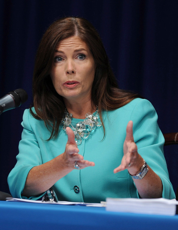 . In this June 23, 2014 file photo, Pennsylvania state Attorney General Kathleen Kane fields questions from the media at a news conference in Harrisburg, Pa. Kane said Wednesday, Nov. 12, 2014 four of her employees have been fired and 11 suspended without pay for involvement in a pornographic email scandal that also prompted a state Supreme Court justice to step down. (AP Photo/Bradley C Bower)