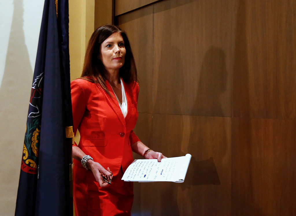 . Pennsylvania Attorney General Kathleen Kane leaves the podium after speaking during a news conference in Scranton, Pa., Tuesday, Feb. 16, 2016. Kane said she will not seek a second term, facing pressure from within her own party after being hobbled for months by criminal perjury charges and the suspension of her law license. (AP Photo/Rich Schultz)