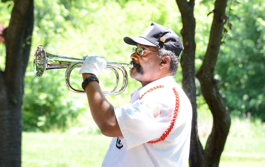 . Vietnam War veteran Billy Worrell plays �Taps � during Flag Day ceremony at Memorial Park in Pottstown. Tom Kelly III � For Digital First Media