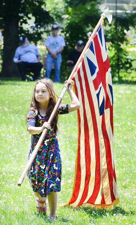 . Girl Scout Gwen Harding carries a flag during Flag Day ceremonies at Memorial Park in Pottstown. Gwen�s was helping her brothers Boy Scout Troop 521 carry flags from different eras. Tom Kelly III � For Digital First Media
