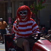 A creepy clown from the Pottstown Temple of Terror rides down High Street during the GoFourth! parade on Tuesday.--Marian Dennis, Digital First Media
