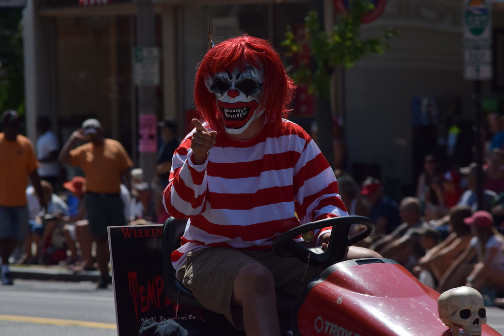 . A creepy clown from the Pottstown Temple of Terror rides down High Street during the GoFourth! parade on Tuesday.--Marian Dennis, Digital First Media
