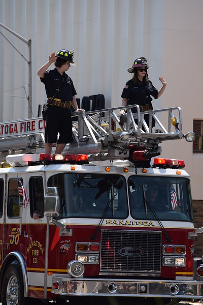 Firefighters from area fire companies including Sanatoga waved to guests as they rode on top of the truck at the Fourth of July Parade in Pottstown on Tuesday. --Marian Dennis, Digital First Media