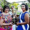 Pottstown High School Principal Danielle McCoy presents a traveling trophy to Angelina Olvera after she was crowned the 2017 Independence Day LTD Queen during a ceremony on the Colbrookdale Railroad.--Tom Kelly, Digital First Media