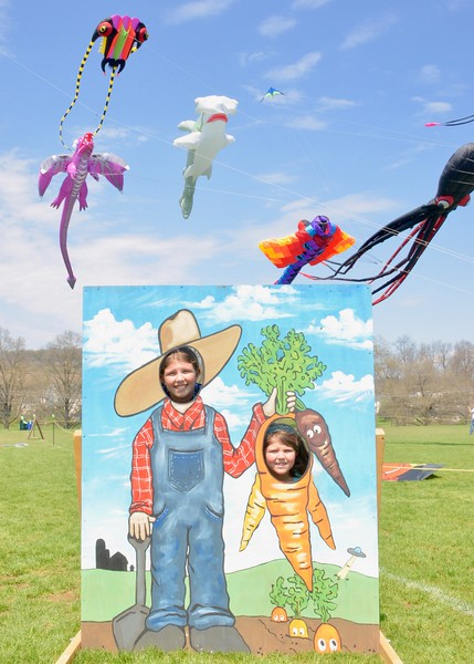 Jesi Yost - Digital First Media <br /> Tara Hirschtritt, 9, and Paige Hirschtritt, 6, of Leesport pose in a farmer and carrot face cutout.