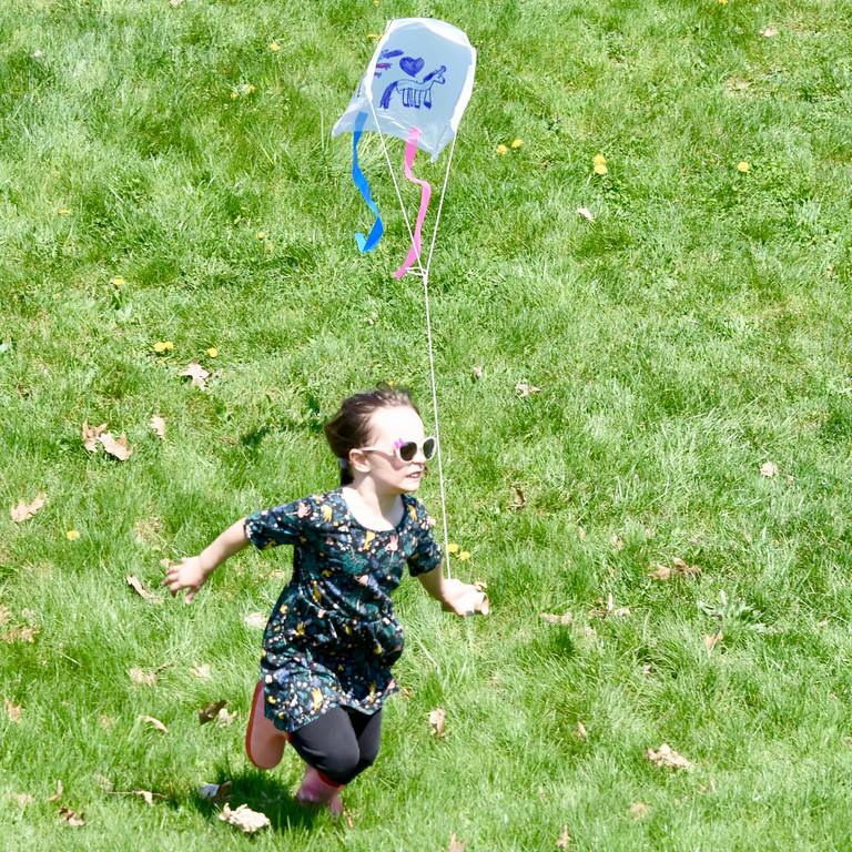 . Jesi Yost - Digital First Media  Celia Hauk, 6, of Mt. Penn with her with her dragon, unicorn, heart, sled kite she made at Go Fly a Kite and Healthy Kids Day in Bern Township on April 28.