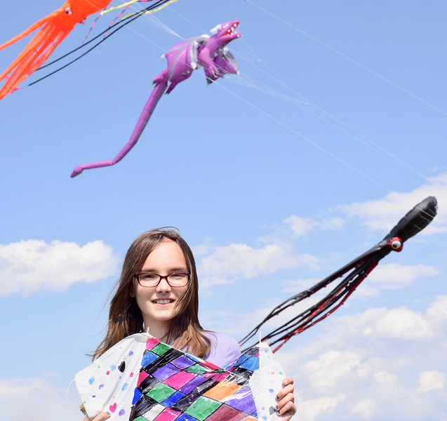 Jesi Yost - Digital First Media <br /> Berks County residents flew kites at the 31st annual Go Fly a Kite! Day on April 28 at the Youth Recreation Facility in Bern Township. Pictured, Lexie F., 10, of Blandon with her sled kite creation.