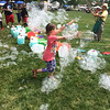 Evan Brandt — Digital First Media<br /> The more bubbles Grandpa Bubbles made, the more the children at Pottstown's GoFourth! Festival chased them across Memorial Park.