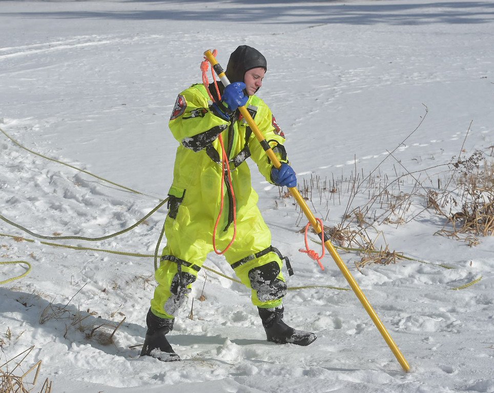. PETE BANNAN-DIGITAL FIRST MEDIA   Firefighter Pat Dixon checks the ice as he moves during training at North Hills pond.