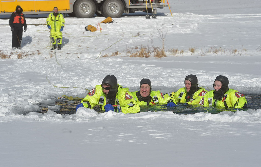 . PETE BANNAN-DIGITAL FIRST MEDIA   Fame firefighters Mark McCarthy, Steve Amway,  Pat Dixon and Nicole McCarthy seem to enjoy the freezing water during training at North Hills pond.