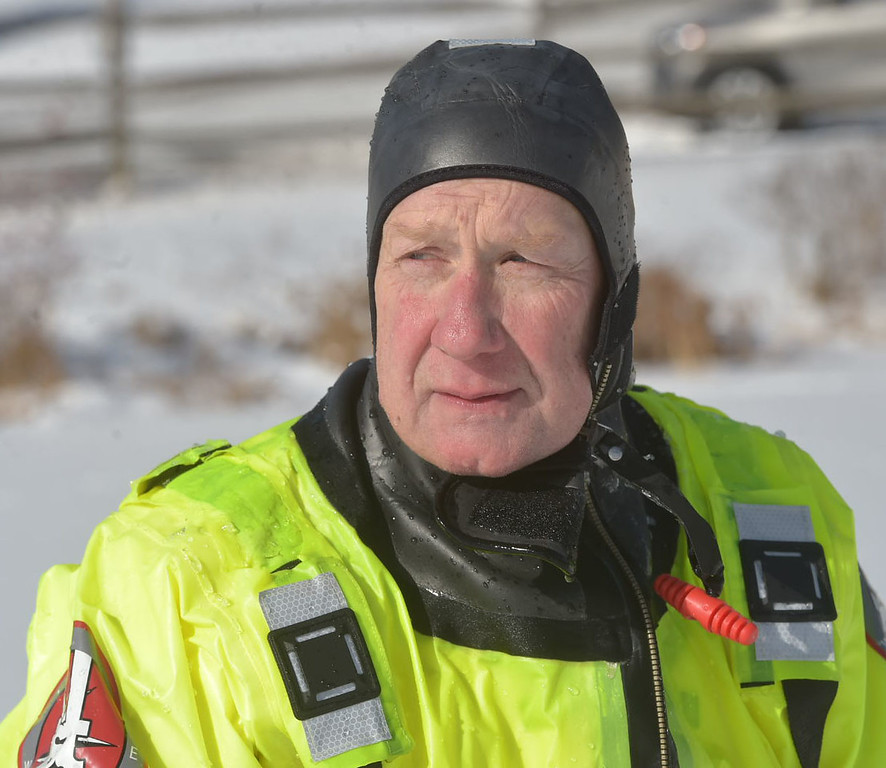 . PETE BANNAN-DIGITAL FIRST MEDIA   Steve Amway takes part on ice training drills. Amway has been a firefighter with Fame for 44 years.