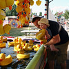 Tom and Christine Nestor watch happily as their son, Robert, pulls out a winning duck from the pond at the Kimberton Fair Wednesday. The fair featured a variety of games, rides and food for families to enjoy.