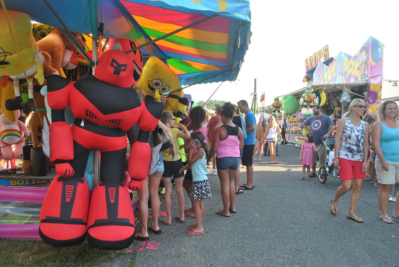 People enjoy the games and the rides at the Kimberton Fair. Photos by Barry Taglieber for Digital First Media