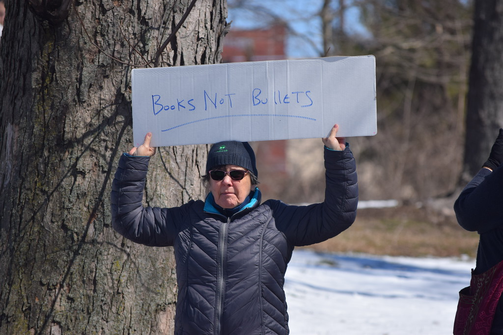 . Marian Dennis � DIgital First Media Many rally-goers in Riverfront Park Saturday brought signs to display while speakers addressed the crowd.