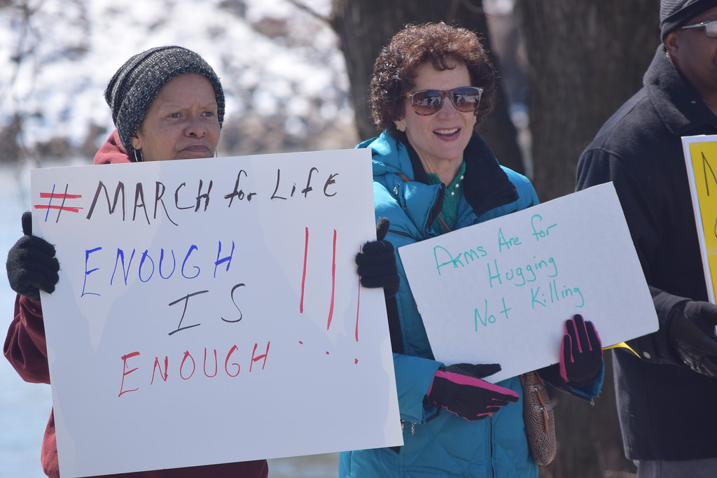 . Marian Dennis � DIgital First Media Rally-goers stood behind speakers with signs of support as the event took place in Riverfront Park Saturday.