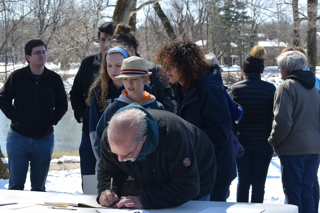 . Marian Dennis � DIgital First Media Attendees at a rally in Pottstown Saturday lined up to sign a petition encouraging them to be a positive change in the community. The rally was one of many planned in solidarity with the March for Our Lives in Washington, D.C.