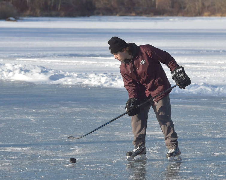 "PETE BANNAN -DIGITAL FIRST MEDIA    Bobby Kiefer of Exton practices Tuesday at Marsh Creek State Park.  ""Playing outside is fantastic,"" he said  as he skated around a cleared section of ice  waiting for friends. ""It's hockey at it's most natural."""