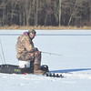 "PETE BANNAN -DIGITAL FIRST MEDIA    Bill Mendenhall of Downingtown ice fishing at Marsh Creek State Park Tuesday. ""The cold isn't really bad, it's the wind.""  <br /> Mendenhall said he has his favorite spots to fish on the lake. The water depth where he was fishing he estimated was ten feet with five inches of ice."