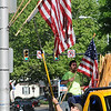 John Strickler - Digital First Media<br /> Kim Bainbridge and Brian Ray put up United States flags along High Street for Memorial Day.
