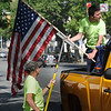 John Strickler - Digital First Media<br /> Pottstown musical employees Brian Ray and Kim Bainbridge put United States flags up along High Street for the Memorial Day holiday.