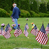 Veteran's and Boy Scouts along with other volunteers placed US Flags on veteran's grave as they get ready for Memorial Day at Highland Memorial Park. Photo by Tom Kelly III - For Digital First Media