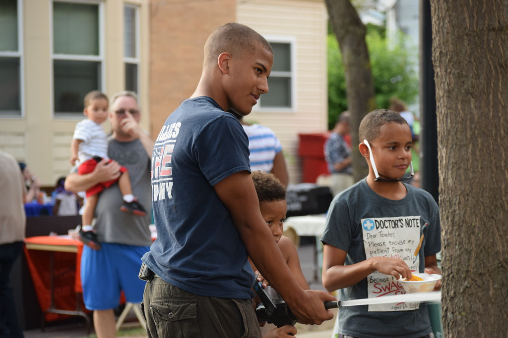 . Volunteer firefighters showed kids how to use a fire hose during the National Night Out event held in Pottstown at Washington and Chestnut streets.  Marian Dennis -- Digital First Media
