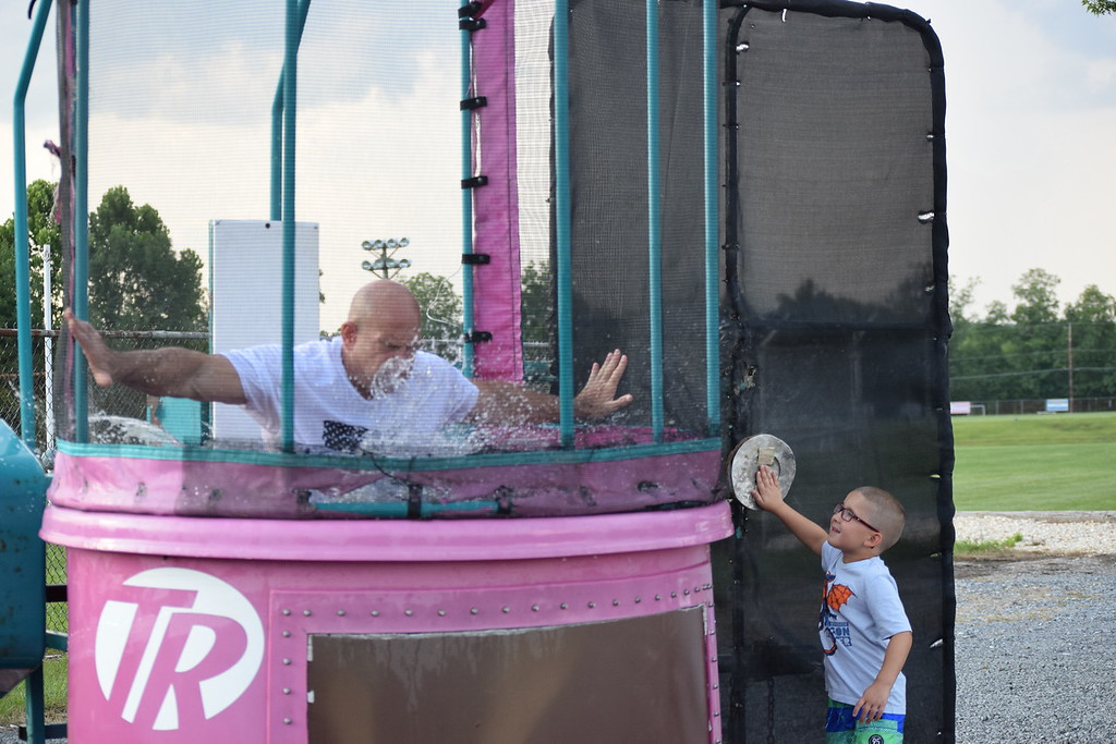 . Amity Police Chief Andrew Kensey gets dunked during Amity Township�s first ever National Night Out event. Marian Dennis -- Digital First Media