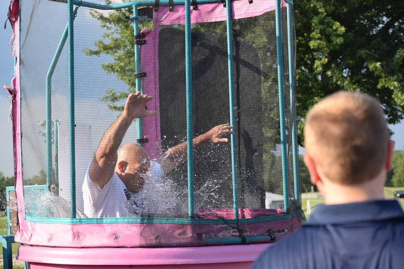 A participant tosses a ball sending Amity Police Chief Andrew Kensey into the dunk tank. This was just one of the many games available to guests who came to the first ever Amity Township National Night out event Tuesday evening.<br /> Marian Dennis -- Digital First Media