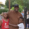 Charles Dennis enjoys Pottstown's National Night Out event with his family, Zhon, 8, and Jayden, 10. The event offered lots of music, games and food for families and community members to enjoy.<br /> Marian Dennis -- Digital First Media