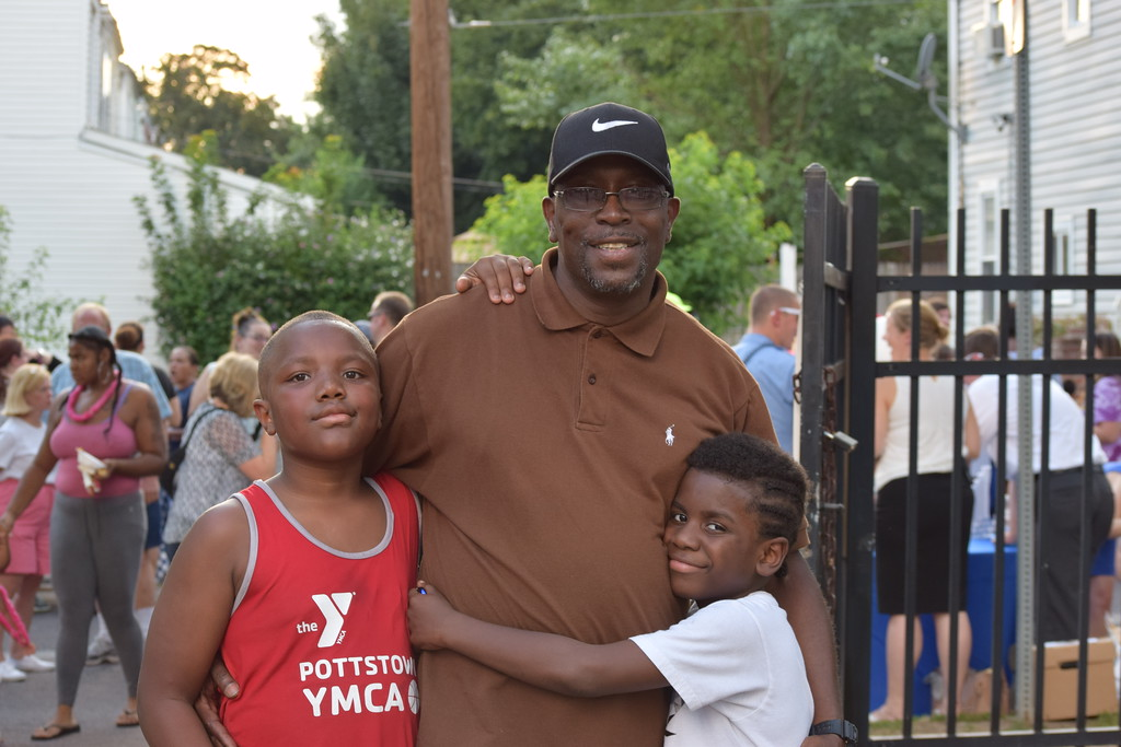 . Charles Dennis enjoys Pottstown�s National Night Out event with his family, Zhon, 8, and Jayden, 10. The event offered lots of music, games and food for families and community members to enjoy. Marian Dennis -- Digital First Media