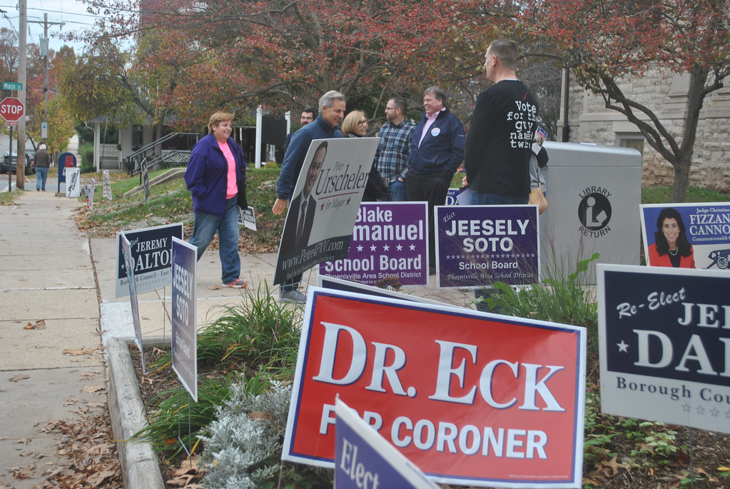 . Barry Taglieber - For Digital First Media  Signs line the front of the Phoenixville Public Library as volunteers and candidates greet the voters on Tuesday.