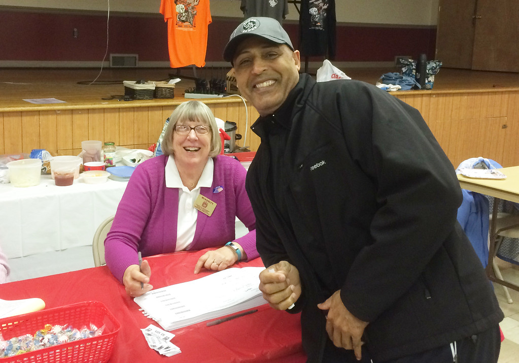 . Evan Brandt -- Digital first Media  Alonzo Belton of Gilbertsville was the 500th voter in District 3 voting at the Gilbertsville firehouse Tuesday. He was congratulated by Pam Ferraro, minority election inespector.