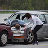A student actor at Owen J. Roberts High School checks on a fellow student after reenacting a fatal crash. The mock crash took place Thursday and was shown to sophomores, juniors and seniors to remind them of the dangerous consequences of drinking and driving.<br /> Marian Dennis-- Digital First Media